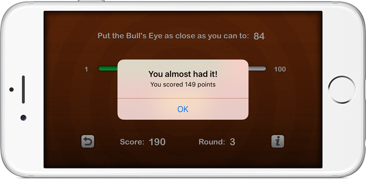 An alert pop-up shows the score